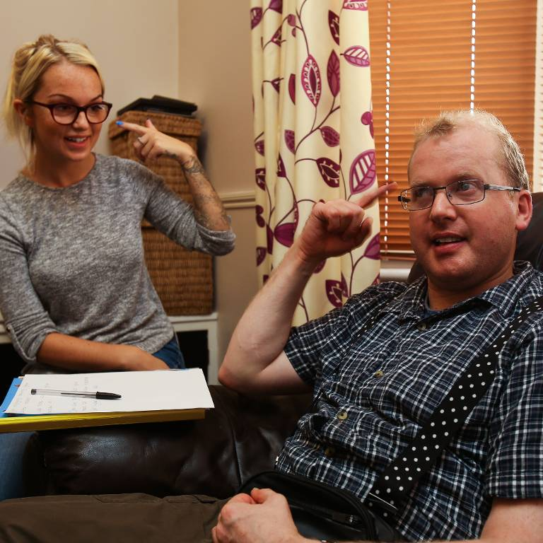 A service user enjoying working on communication with a support worker